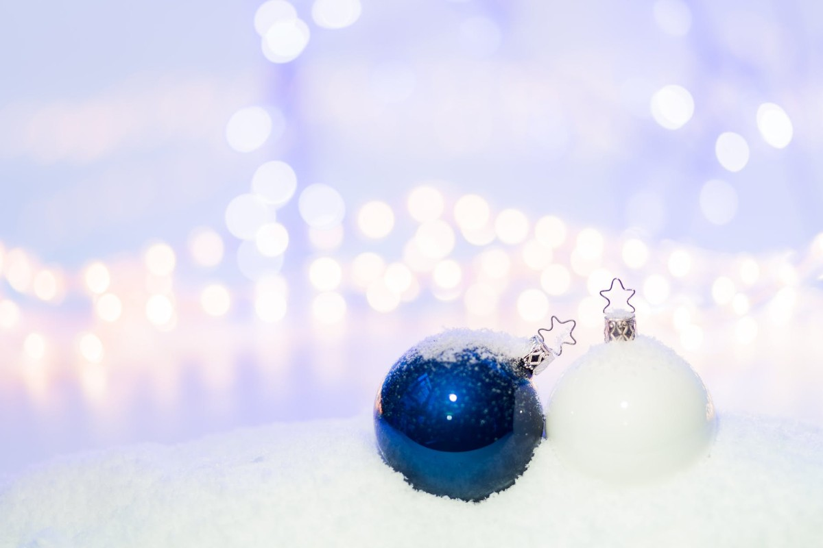 Blue and White Round Christmas Ornament on Snow