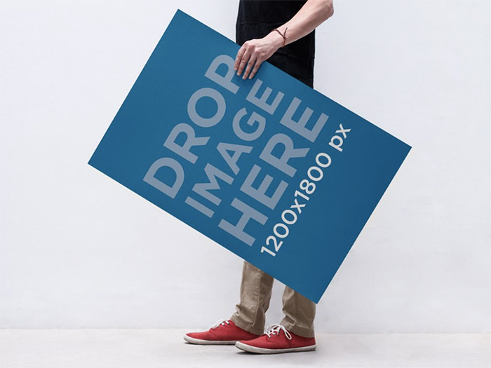 man-holding-poster