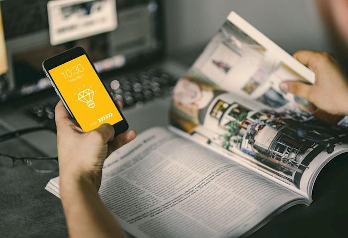 free-magazine-iphone-hand-mockup-psd
